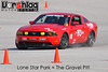 SCCA at Lone Star Park, April 10, 2011 : Took the Mustang to an autocross at Lone Star Park with the SCCA, and The Gravel Pit was especially messy today. Some new parts had teething problems and Costas and Terry took only half of their runs, and those only tentatively. Once repairs were made Amy had 4 solid runs and fared well, winning the &quot;W&quot; PAXed class and beating the boys co-driving in the Mustang. We got some good test data and are eager to run the car again soon with this latest round of changes, plus more.