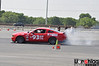 SCCA at TMS, May 20, 2012 : Terry ran the Mustang in ESP on a new set of Hoosier A6 tires in sizes 315/30/18 up front and 345/35/18 on the rear. Lots of rear tire rub (inboard) that we need to fix, and the JLT oil/air separator broke a large bore vacuum line that killed brake booster power, so there were some unusual issues slowing the car down. Still, it was quickest in the first heat and led PAX until the later heats ran in cleaner and warmer conditions. :) Good test before the SCCA Spring Nationals the following weekend.