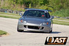 Aaron Leichty's S2000 : Aaron was one of our first S2000 AST testers in 2008 and he's out breaking records in NASA Time Trial in 2009. Here are some pictures from his first outing at Putnam Park, where he shattered the TTC record by 3 seconds, beat the TTB record by a second, and almost nabbed the TTA record... in a TTC car. His car has AST 4100s, a wing and tires - that's it. Check the in car video linked below, also.