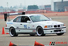 "Mike Simanyi's '95 BMW M3, SMod Prepped : Mike's 1995 M3 autocross car used to be built for STU class racing but in 2009 he switched to Street Modified class prep. He took a simple approach and built the car to be light, have a good suspension, use a reasonable tire width, and a high revving naturally aspirated motor. The car weighs 2600 pounds, has a built 3.0L motor with 300 whp, AST 5200s, Vorshlag camber plates, and Mason shock tower brace. Tires are 285/30/18 Hoosiers on 18x10"" wheels with custom steel wheel flares. Mike took the car to a dominant win at the 2009 SCCA Solo Championship in SMod, and the car also won SML handily!"