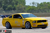 "Tim Bergstrom's 2006 Mustang GT (STX -> ESP) : Tim is another S197 tester for us and he's running the following parts he got from us: Vorshlag camber/caster plates, AST 4100s, and Hyperco coilover springs. He has been racing his 2006 GT on Tokico shocks and H&R lowering springs, and the move to AST 4100s and stiffer coilover springs should significantly improve his autocross performance. Tim has been racing in the SCCA ""STX"" class in 2010 and plans to continue there in 2011. Tim also noted, ""As an added bonus the AST's were 10 lbs. lighter each side than the Tokico D- specs, so now the car weighs 3310"" pounds.   Tim moved his car to ESP and he and his co-driver Britt Dollmeyer placed 11th and 2nd at the 2012 SCCA Solo Nationals."